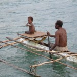This charming photo of father and son paddling off after a day at the market was taken at Alexishafen north of Madang.
