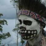 A young woman takes on the frightening appearance of the living dead at a Mt. Hagen Cultural Show